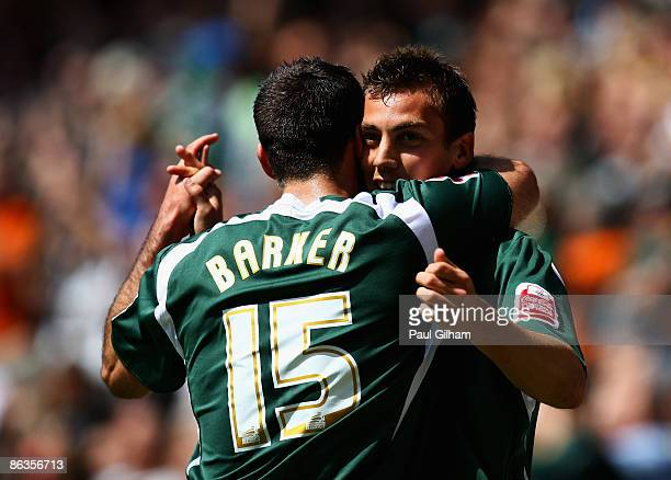Gary Sawyer of Plymouth Argyle celebrates with Chris Barker after scoring the first goal for Plymouth during the CocaCola Championship match between...
