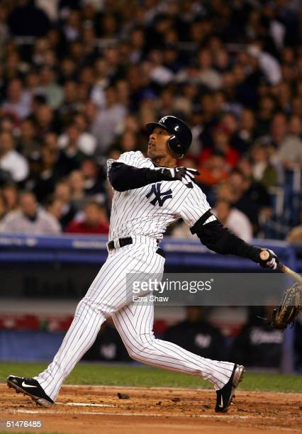Gary Sheffield hits an RBI single against the Boston Red Sox in the first inning during game two of the American League Championship Series on...