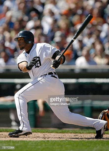 Gary Sheffield of the Detroit Tigers hits an RBI sacrifice fly to score Brandon INge in the bottom of the third inning against the Toronto Blue Jays...