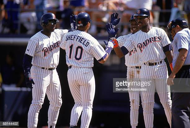 Gary Sheffield of the San Diego Padres celebrates with teammates Tony Gwynn Tony Fernandez and Fred McGriff as he walks to the dugout during a 1992...