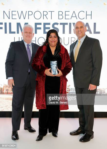Gary Sherwin and Gregg Schwenk present Gurinder Chadha with the Icon Award at the Newport Beach Film Festival UK Honours in association with Visit...