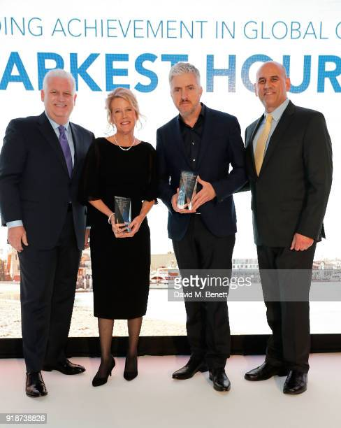 Gary Sherwin and Gregg Schwenk present Lisa Bruce and Anthony McCarten with the Outstanding Achievement in Global Cinema honour for 'Darkest Hour' at...