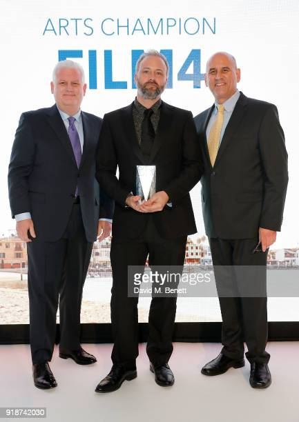 Gary Sherwin and Gregg Schwenk present Sam Lavender with an Arts Champions honour at the Newport Beach Film Festival UK Honours in association with...