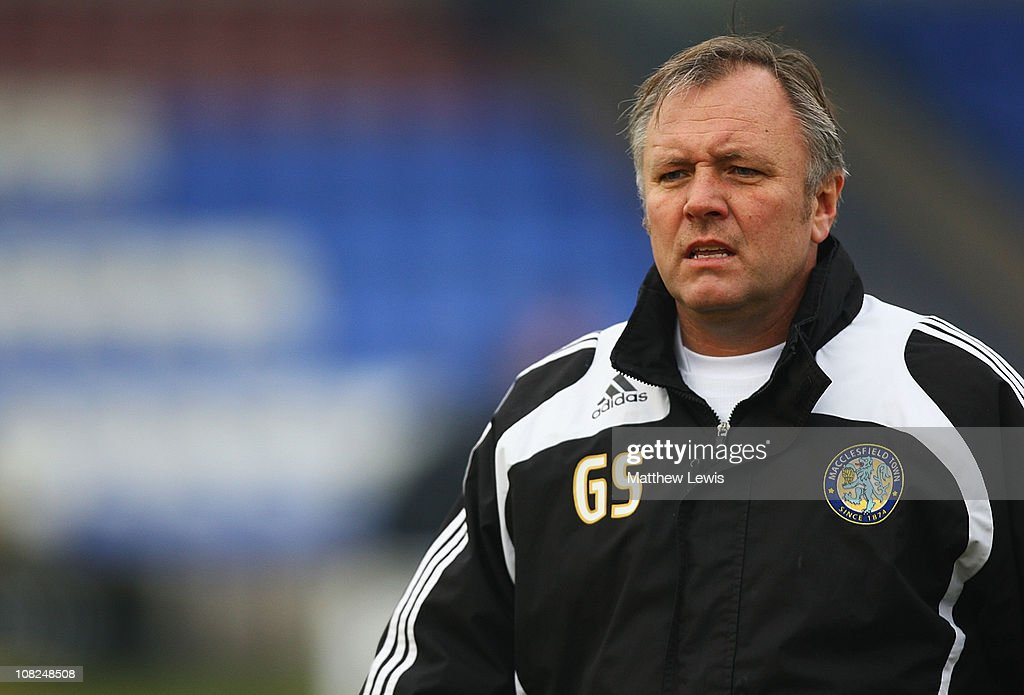 Gary Simpson, manager of Macclesfield Town looks on during the npower League Two match between Macclesfield Town and Barnet at the Moss Rose Stadium on January 22, 2011 in Macclesfield, England.
