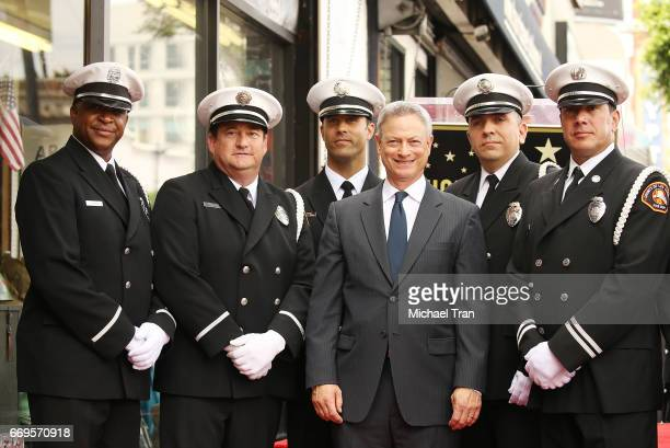 Gary Sinise poses with members of the Los Angeles Fire department color guard at the ceremony honoring him with a Star on The Hollywood Walk of Fame...