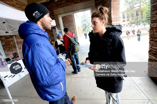 Gary Sorcher of New Era Colorado talks to Tawny Strelich about Ballot Initiative 310 during the groups outreach on the CU Boulder Campus Tuesday. For...