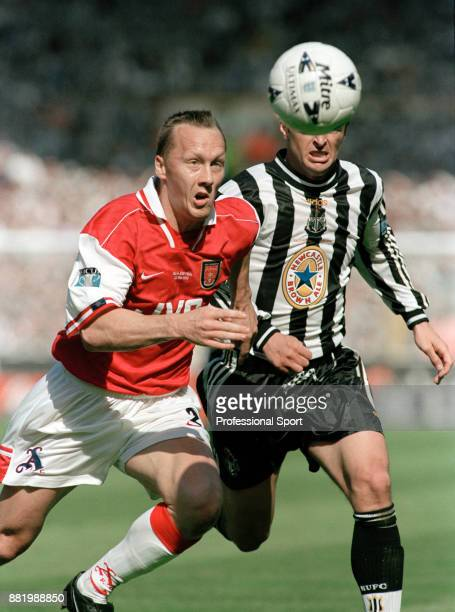 Gary Speed of Newcastle United tracks Lee Dixon of Arsenal during the FA Cup Final at Wembley Stadium on May 16 1998 in London England