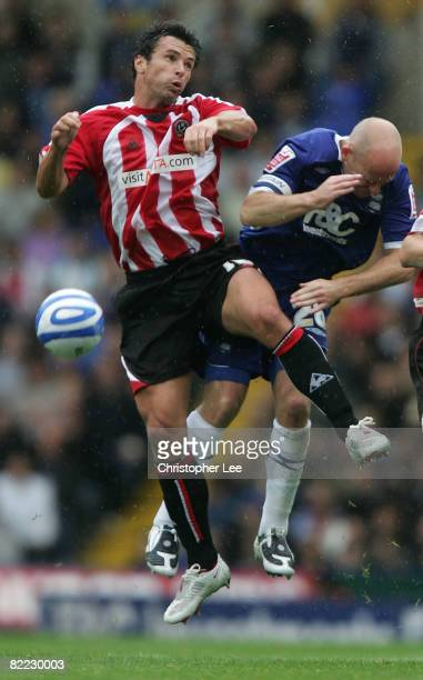 Gary Speed of Sheffield United jumps for the ball with Lee Carsley of Birmingham during the CocaCola Championship match between Birmingham City and...