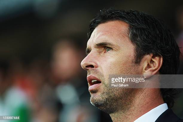 Gary Speed the Wales manager lines up for the national anthems before the UEFA EURO 2012 group G qualifying match between Wales and Montenegro at the...