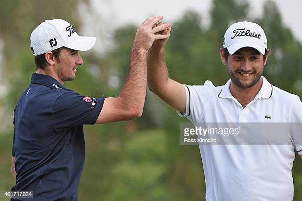 Gary Stal of France celebrates his putt on the 16th hole with Alexander Levy during the final round of the Abu Dhabi HSBC Golf Championship at the...