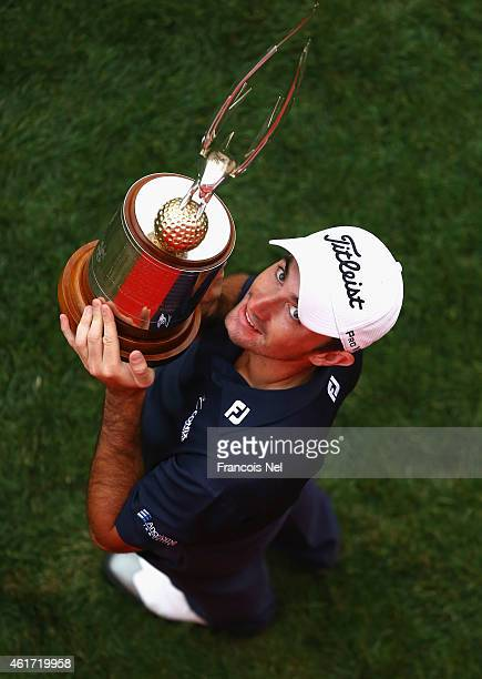 Gary Stal of France celebrates with the winners trophy after the final round of the Abu Dhabi HSBC Golf Championship at Abu Dhabi Golf Club on...