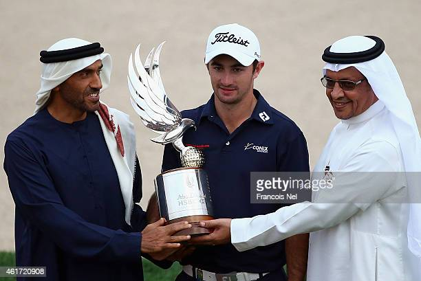 Gary Stal of France is presented with the winners trophy by Sheik Nahyan Bin Zayed Al Nahyan Chairman of Abu Dhabi Sports Council and Mohammad...