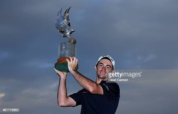 Gary Stal of France proudly holds the trophy after his win in the Abu Dhabi HSBC Golf Championship at Abu Dhabi Golf Club on January 18 2015 in Abu...