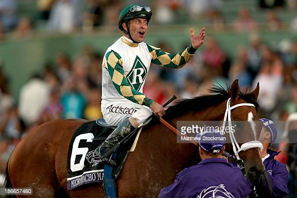 Gary Stevens celebrates aboard Mucho Macho Man after winning the Breeders' Cup Classic during the 2013 Breeders' Cup World Championships at Santa...