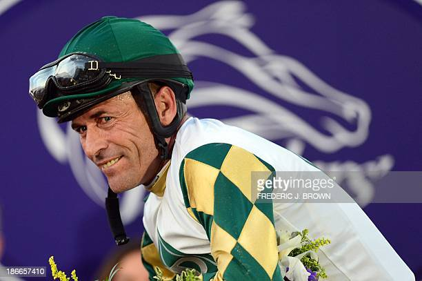 Gary Stevens smiles after riding Mucho Macho Man to victory in the Breeder's Cup Classic race at the Santa Anita Racetrack in Arcadia California on...