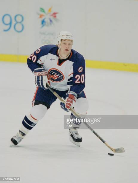Gary Suter of the United States controls the puck during the Group D game against Canada in the Men's Ice Hockey tournament on 16 February 1998...
