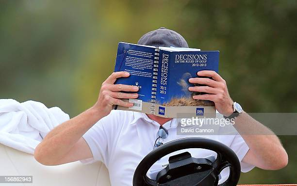 Gary Tait the European tour referee studying his rule book whilst on duty during the second round of the 2012 DP World Tour Championship on the Earth...