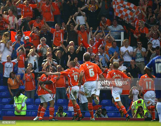 Gary TaylorFletcher of Blackpool celebrates with teammates after scoring his teams first goal during the Coca Cola Championship match between...