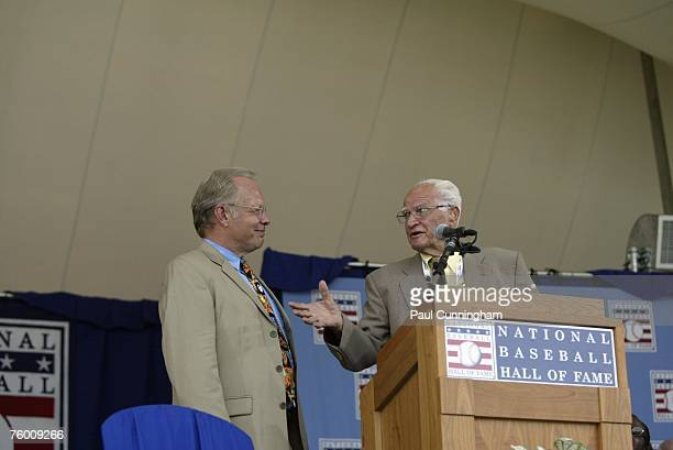 Gary Thorn of ESPN and Bobby Doerr talk on stage during the Baseball Hall of Fame Induction Ceremonies at the Clark Sports Center in Cooperstown New...
