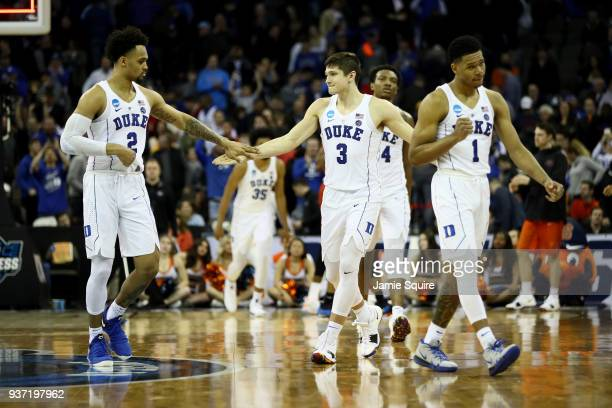 Gary Trent Jr #2 Grayson Allen and Trevon Duval of the Duke Blue Devils celebrate after defeating the Syracuse Orange in the 2018 NCAA Men's...