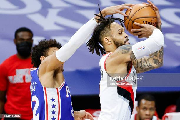 Gary Trent Jr. #2 of the Portland Trail Blazers is blocked by Matisse Thybulle of the Philadelphia 76ers during the first quarter at Wells Fargo...