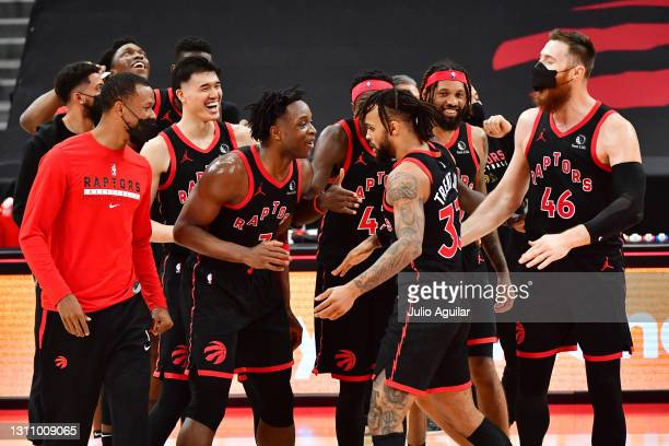Gary Trent Jr. #33 of the Toronto Raptors celebrates with teammates Aron Baynes, DeAndre' Bembry, OG Anunoby, Pascal Siakam, and Yuta Watanabe after...