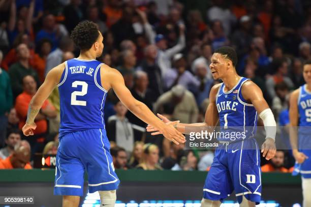 Gary Trent Jr celebrates with Trevon Duval of the Duke Blue Devils after hitting a three point basket in the second half of the game against the...