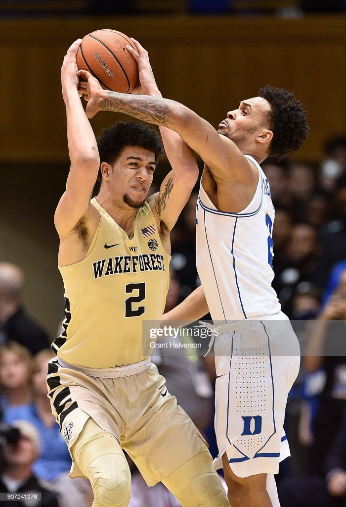 Gary Trent Jr #2 of the Duke Blue Devils forces a turnover by Donovan Mitchell #2 of the Wake Forest Demon Deacons during their game at Cameron Indoor Stadium on January 13, 2018 in Durham, North Carolina.