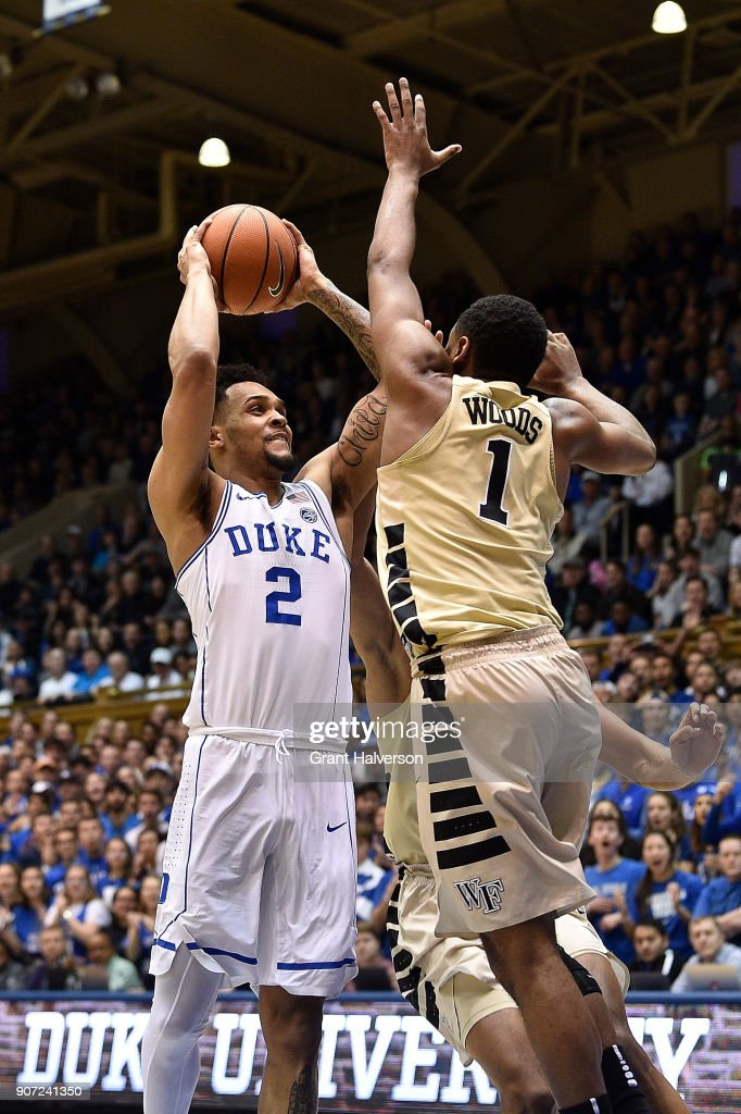 Gary Trent Jr #2 of the Duke Blue Devils shoots against Keyshawn Woods #1 of the Wake Forest Demon Deacons during their game at Cameron Indoor Stadium on January 13, 2018 in Durham, North Carolina. Duke won 89-71.