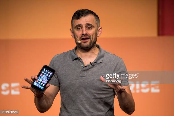 Gary Vaynerchuk chief executive officer of VaynerMedia LLC holds a smartphone as he speaks during the Rise conference in Hong Kong China on Tuesday...