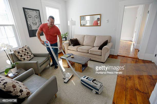 Gary Wagner vaccums the half of his home he rents out on Airbnb after guests had left Thursday October 8 2015