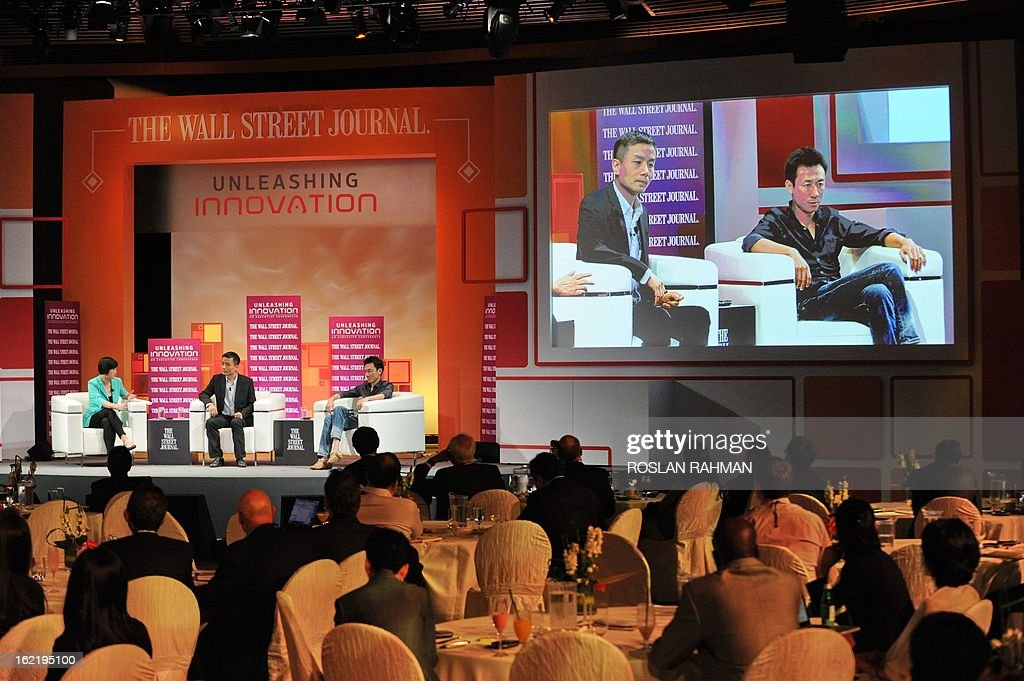 Gary Wang (sitting R), founder of Tudou.com and Michael Anti (sitting C), journalist, political commentator and microblogger attend the Wall Street Journal Unleashing Innovation executive conference held at Capella Singapore, Sentosa Island in Singapore on February 20, 2013. The conference which is the being held for the first time from February 19-21 in Singapore is attended by global leaders from business, government and academia with expertise in information technology, biotechnology and clean tech, to provide practical advice on strategies to drive innovation in organisations.