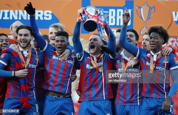 Gary Warren of Inverness Caledonian Thistle lifts the trophy during the IRNBRU Scottish Challenge Cup Final between Dumbarton FC v Inverness...