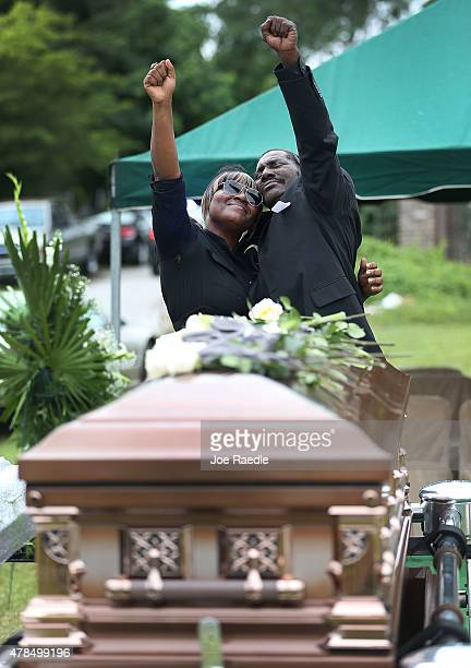 Gary Washington and a family member spend a moment with his mother Ethel Lance before she is buried at the AME Church cemetery she was one of nine...