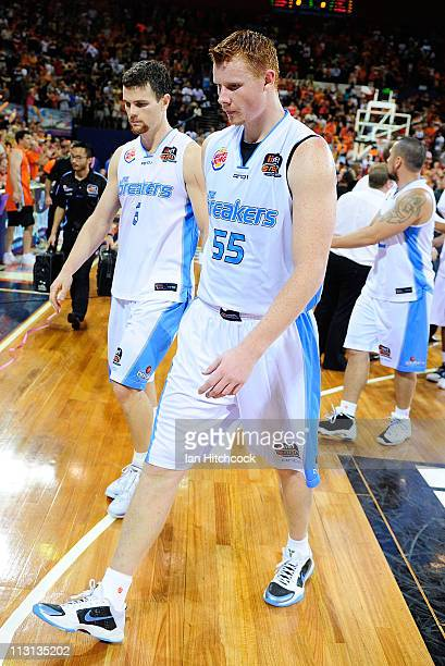 Gary Wilkinson and Kirk Penney of th Breakers walk off the court after losing game two of the NBL Grand Final series between the Cairns Taipans and...