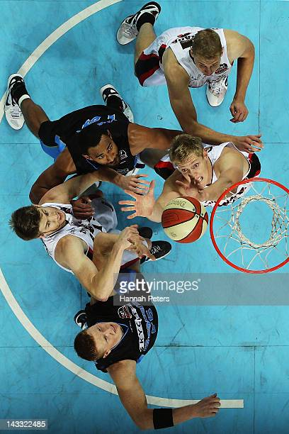Gary Wilkinson and Mika Vukona of the Breakers compete with Shawn Redhage and Cameron Tovey of the Wildcats during game three of the NBL Grand Final...