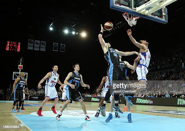 Gary Wilkinson of the Breakers Daniel Johnson of the Adelaide 36ers compete for a rebound during the NBL Rd 6 match between New Zealand and Adelaide...