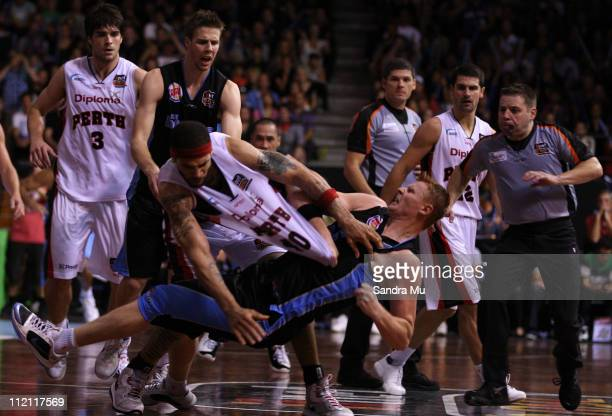 Gary Wilkinson of the Breakers falls to the ground after a personal foul from Andre Brown of the Wildcats during game three of the SemiFinal series...