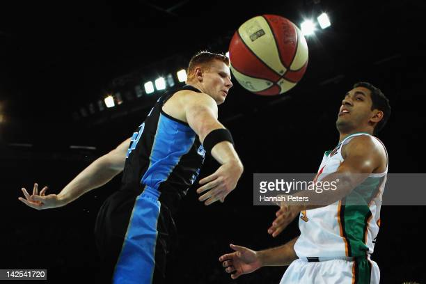 Gary Wilkinson of the Breakers knocks the ball down from Chris Cedar of the Crocodiles during game three of the NBL Finals series between the...