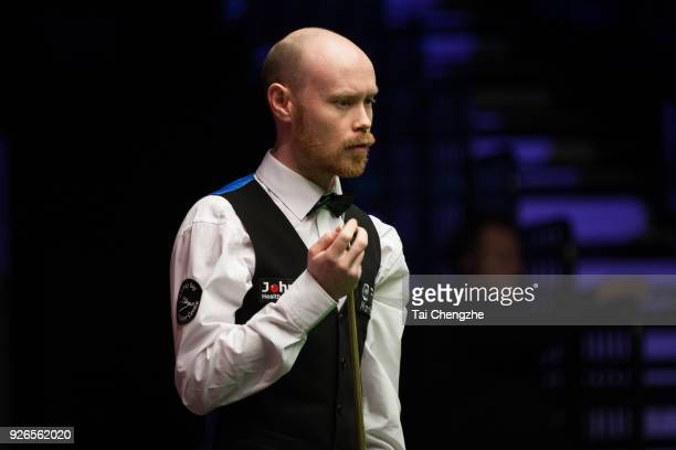 Gary Wilson of England chalks the cue during his quarterfinal match against Yu Delu of China on day five of 2018 ManBetX Welsh Open at Motorpoint...
