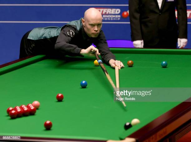 Gary Wilson of England in action during his first round match against Ronnie O'Sullivan of England on day one of the World Championship Snooker at...