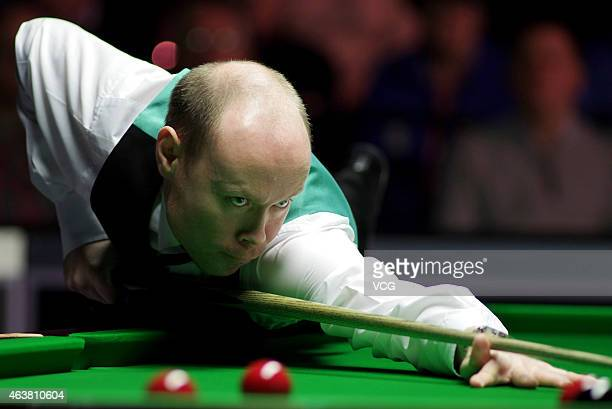 Gary Wilson of England plays a shot against Joe Perry of England during day three of 2015 BetVictor Welsh Open at Motorpoint Arena on February 18...