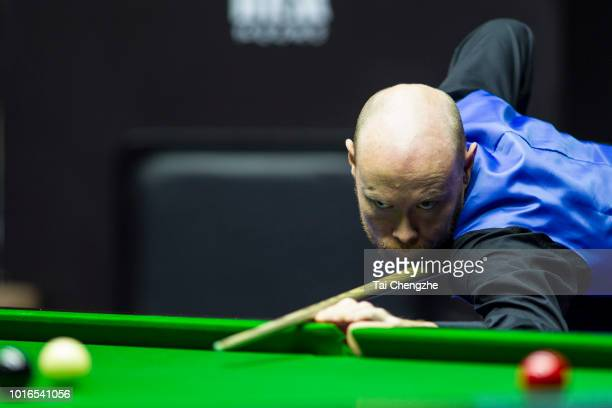 Gary Wilson of England plays a shot during his quarterfinal match against Barry Hawkins of England on day five of the 2018 Yushan World Open at...