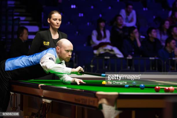 Gary Wilson of England plays a shot during his quarterfinal match against Yu Delu of China on day five of 2018 ManBetX Welsh Open at Motorpoint Arena...