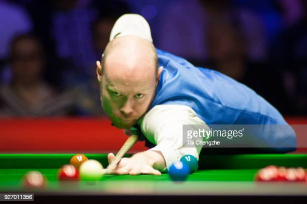 Gary Wilson of England plays a shot during the semifinal match against John Higgins of Scotland on day six of 2018 ManBetX Welsh Open at Motorpoint...