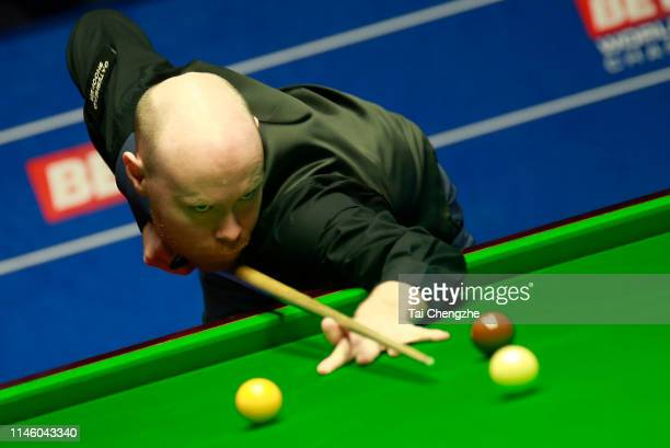Gary Wilson of England plays a shot in the quarterfinal match against Ali Carter of England on day eleven of the 2019 Betfred World Snooker...