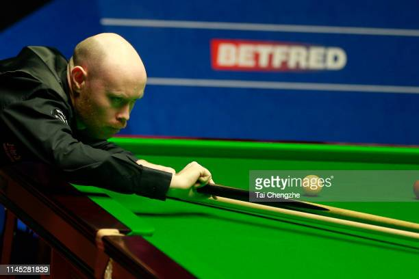 Gary Wilson of England plays a shot in the second round match against Mark Selby of England during day seven of the 2019 Betfred World Snooker...
