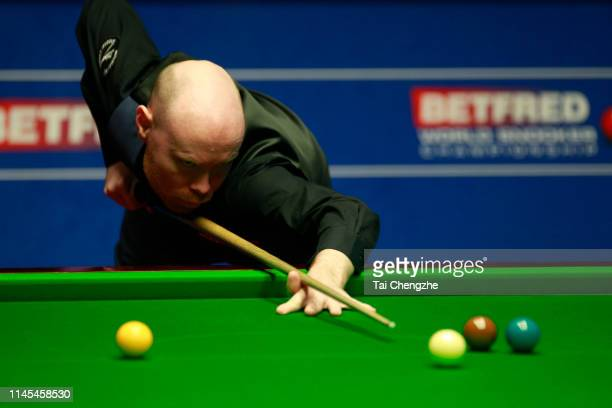 Gary Wilson of England plays a shot in the second round match against Mark Selby of England during day eight of the 2019 Betfred World Snooker...