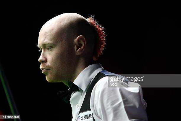 Gary Wilson of England reacts during the first round match against Stephen Maguire of Scotland on day one of China Open at Beijing University...