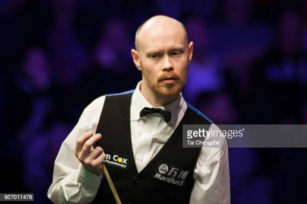 Gary Wilson of England reacts during the semifinal match against John Higgins of Scotland on day six of 2018 ManBetX Welsh Open at Motorpoint Arena...